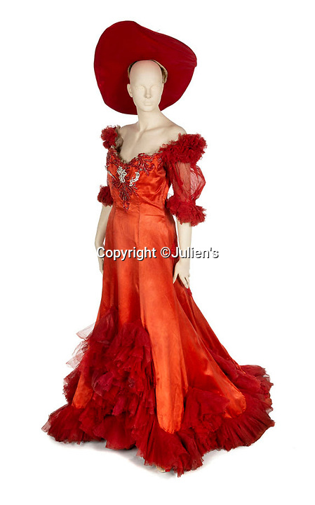 """BNPS.co.uk (01202 558833)<br /> Pic:  Julien's/BNPS<br /> <br /> A custom made scarlet red satin gown worn by Mae West in the 1950 production of Diamond Lil, est. £16,000.<br /> <br /> A selection of trailblazing 1930s starlet Mae West's most recognisable film costumes have emerged for sale for £320,000. ($400,000)<br /> <br /> The auction features the actress and screenwriter's gowns, headdresses and tiaras, as well as props from her films and her scripts.<br /> <br /> West, a New York native, was the Marilyn Monroe of her era, earning a 'bad girl' reputation for starring in risque productions.<br /> <br /> She famously coined the phrase: """"When I'm good, I'm very good, but when I'm bad, I'm better."""""""