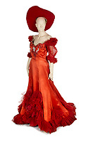 "BNPS.co.uk (01202 558833)<br /> Pic:  Julien's/BNPS<br /> <br /> A custom made scarlet red satin gown worn by Mae West in the 1950 production of Diamond Lil, est. £16,000.<br /> <br /> A selection of trailblazing 1930s starlet Mae West's most recognisable film costumes have emerged for sale for £320,000. ($400,000)<br /> <br /> The auction features the actress and screenwriter's gowns, headdresses and tiaras, as well as props from her films and her scripts.<br /> <br /> West, a New York native, was the Marilyn Monroe of her era, earning a 'bad girl' reputation for starring in risque productions.<br /> <br /> She famously coined the phrase: ""When I'm good, I'm very good, but when I'm bad, I'm better."""