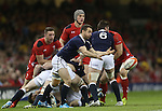 Scotland scrum half Greig Laidlaw whips the ball away from the breakdown.<br /> RBS 6 Nations 2014<br /> Wales v Scotland<br /> Millennium Stadium<br /> <br /> 15.03.14<br /> <br /> &copy;Steve Pope-SPORTINGWALES