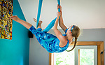 HARWINTON , CT-080620JS13—Sarah Reeves, 15, of Terryville, works an her aerial sling hammock routine during the Thrive Movement Studio's circus camp Thursday at their studio in Harwinton. <br />  Jim Shannon Republican-American