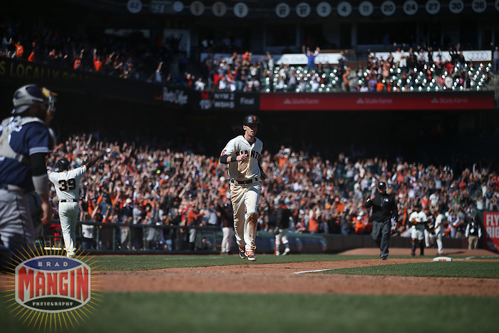 SAN FRANCISCO, CA - MAY 25:  Matt Duffy #5 of the San Francisco Giants scores the game-winning run in the bottom of the 10th inning against the San Diego Padres during the game at AT&T Park on Wednesday, May 25, 2016 in San Francisco, California. Photo by Brad Mangin