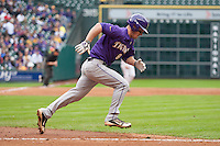LSU Tigers shortstop Alex Bregman (8) runs to first base during the NCAA baseball game against the Baylor Bears on March 7, 2015 in the Houston College Classic at Minute Maid Park in Houston, Texas. LSU defeated Baylor 2-0. (Andrew Woolley/Four Seam Images)