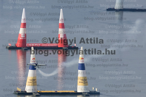 0708185340a Red Bull Air Race international air show practice runs over the river Danube, Budapest preceding the anniversary of Hungarian state foundation. Hungary. Saturday, 18. August 2007. ATTILA VOLGYI