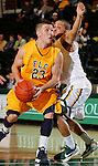 SPEARFISH, SD - JANUARY 5, 2013:  Nick Tomsick #23 of Fort Lewis College drives past Joey Mitchell #5 of Black Hills State during their Rocky Mountain Athletic Conference basketball game Saturday at the Young Center in Spearfish, S.D.  (Photo by Richard Carlson/dakotapress.org)