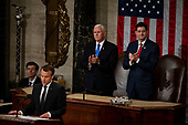 United States Vice President Mike Pence and Speaker of the House of Representatives Paul Ryan, Republican of Wisconsin, applaud as French President Emmanuel Macron delivers a joint address to the United States congress at the United States Capitol in Washington, DC on April 25, 2018. Credit: Alex Edelman / CNP