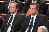 United States Senators Pat Toomey (Republican of Pennsylvania), left, and Ted Cruz (Republican of Texas), right, listen as President Donald J. Trump delivers his first State of the Union address to a joint session of the US Congress in the US House chamber in the US Capitol in Washington, DC on Tuesday, January 30, 2018.<br /> Credit: Ron Sachs / CNP