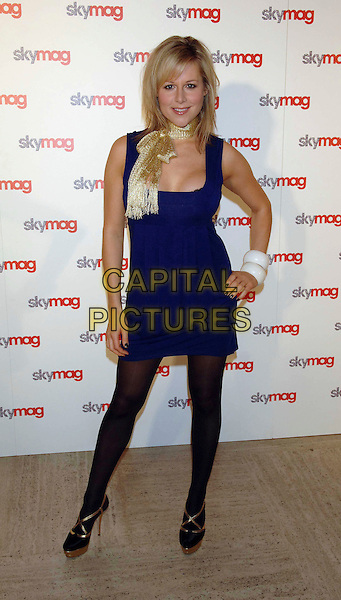 ABI TITMUSS.Skymag launch party at The Bloomsbury Ballroom, London, England. .September 25th, 2007 .full length blue dress black tights gold strap shoes platform hand on hip white bracelets scarf.CAP/WIZ.©Wizard/Capital Pictures.