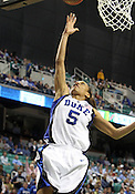 Duke guard Jasmine Thomas makes a layup in the second half. Thomas scored 12 total points. This game was one of the two Semifinal games of the 2011 ACC Tournament in Greensboro on Saturday, March 5, 2011. Duke beat Georgia Tech 74-66. (Photo by Al Drago)