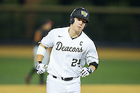 Gavin Sheets (24) of the Wake Forest Demon Deacons rounds the bases after hitting a home run against the USC Trojans at David F. Couch Ballpark on February 24, 2017 in  Winston-Salem, North Carolina.  The Demon Deacons defeated the Trojans 15-5.  (Brian Westerholt/Four Seam Images)