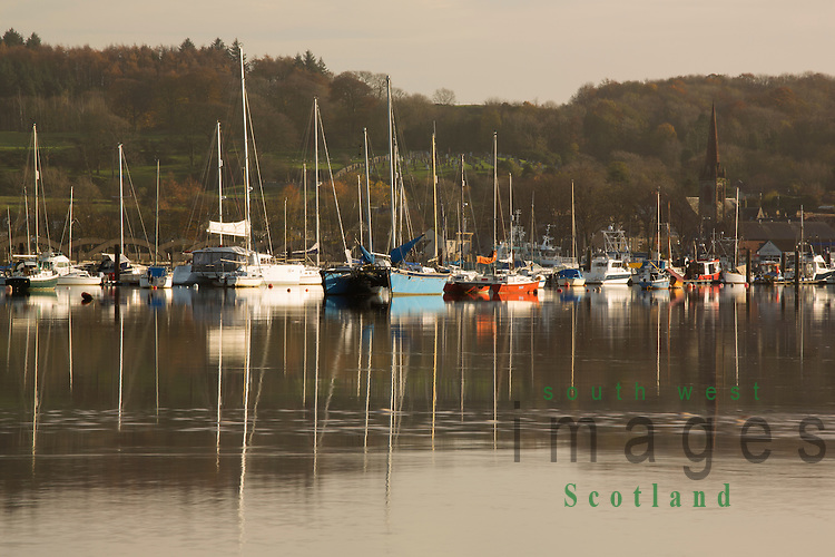High tide at Kirkcudbright, winter boats reflected in the glass like river Dee looking up to Kirkcudbright and its harbour