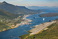 Cruise ship in Tongass Narrows and the town of Ketchikan, southeast, Alaska. Ketchikan International Airport