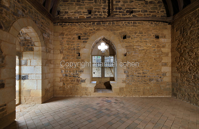 Gable end window in the Great Hall or Grande Salle of the North Range or Logis Seigneurial, completed in 2010, at the Chateau de Guedelon, a castle built since 1997 using only medieval materials and processes, photographed in 2017, in Treigny, Yonne, Burgundy, France. The Guedelon project was begun in 1997 by Michel Guyot, owner of the nearby Chateau de Saint-Fargeau, with architect Jacques Moulin. It is an educational and scientific project with the aim of understanding medieval building techniques and the chateau should be completed in the 2020s. Picture by Manuel Cohen