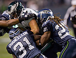 Philadelphia Eagles tight end Brent Celek is gang tackled by Seattle Seahawks Earl Thomas, left, Kam Chancellor and Richard Sherman at CenturyLink Field in Seattle, Washington on December 1, 2011. The Seahawks beat the Eagles 31-14. ©2011 Jim Bryant Photo. All Rights Reserved.