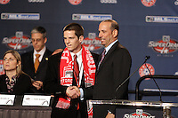 1st Round 2nd draft pick Sam Cronin selected by Toronto FC shaking hands with MLS Commissioner Don Garber at the MLS Super Draft 2009.