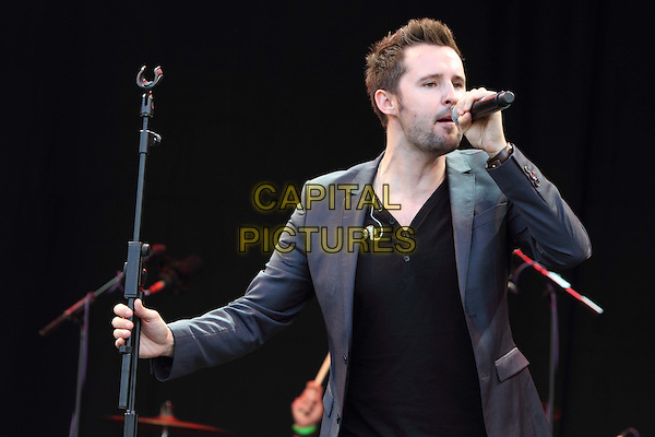 Key West.at the Love Luton Festival Day One at Popes Meadow, Luton, Bedfordshire, UK, July 6th 2012..Music concert live on stage gig performing half length microphone singing grey gray jacket suit black t-shirt blazer .CAP/ROS.©Steve Ross/Capital Pictures