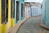 Metal grills protecting windows along a cobblestone street, Sancti Spiritus, Cuba.