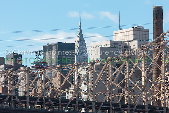 The newly renovated Roosevelt Island Tram with the Queensboro Bridge and Manhattan skyline in the background.