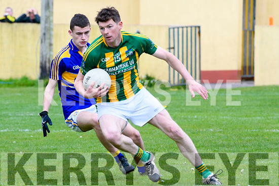 Lios Póil Deaclan Ó Súilleabhain in possession of the ball closely watched by Cordal Padraig Brosnan during the Junior Football Championship match at Lispole GAA Grounds on Sunday afternoon.