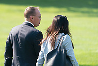 Acting White House Chief of Staff Mick Mulvaney and White House Press Secretary Stephanie Grisham board Marine One to depart the White House with United States President Donald J. Trump, August 7, 2019 to visit El Paso, TX and Dayton Ohio after recent shootings in those cities. <br /> CAP/MPI/RS<br /> ©RS/MPI/Capital Pictures