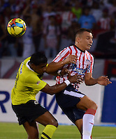 BARRANQUIILLA -COLOMBIA-24-11-2013. Samuel Antonio Vanegas (Der.) de Atlético Junior disputa el balón con Farid Diaz (Izq.) de Atlético Nacional durante partido por la fecha 3 de los cuadrangulares finales de la Liga Postobón II 2013 jugado en el estadio Metropolitano Roberto Meléndez de la ciudad de Barranquilla./ Atletico Junior  player Samuel Antonio Vanegas (R) fights for the ball with Atletico Nacional player Farid Diaz (L) during match for the 3rd date of final quadrangulars of the Postobon League II 2013 played at Metropolitano Roberto Melendez stadium in Barranquilla city.  Photo: VizzorImage/Alfonso Cervantes/STR