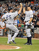 Baltimore, MD - August 31, 2009 -- New York Yankees first baseman Mark Teixeira(25) and left fielder Johnny Damon (18) celebrate after scoring on Robinson Cano's double in the eighth inning against the Baltimore Orioles at Oriole Park at Camden Yards in Baltimore, MD on Monday, August 31, 2009.  The Yankees won the game 5 - 1..Credit: Ron Sachs / CNP.(RESTRICTION: NO New York or New Jersey Newspapers or newspapers within a 75 mile radius of New York City)