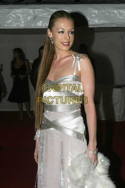 CAT DEELEY.Moet & Chandon Fashion Tribute 2005 to Matthew Williamson, Old Billingsgate Market, London, .February 16th 2005..half length white velvet silver dress straps long straight hair extensions.Ref: AH.www.capitalpictures.com.sales@capitalpictures.com.©Capital Pictures.