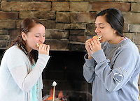 Nicole Burkett (left), 20 and Lauren Navarrete. 22, make and enjoy S'mores as they participate in the Great American Campout Saturday June 27, 2015 in Middletown Twp., Pennsylvania. . (Photo by William Thomas Cain)