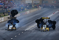 Jul. 19, 2014; Morrison, CO, USA; NHRA top fuel driver Richie Crampton (right) alongside Khalid Albalooshi during qualifying for the Mile High Nationals at Bandimere Speedway. Mandatory Credit: Mark J. Rebilas-