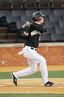 Conor Keniry (14) of the Wake Forest Demon Deacons follows through on his swing against the Georgetown Hoyas at Wake Forest Baseball Park on February 16, 2014 in Winston-Salem, North Carolina.  The Demon Deacons defeated the Hoyas 3-2.  (Brian Westerholt/Four Seam Images)