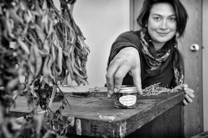 Laura, a young female farmer jarring herbs at Keith's Organic Farm in Port Jervis, New York