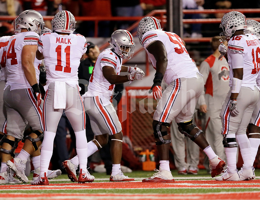 Ohio State Buckeyes wide receiver K.J. Hill (14) celebrates a touchdown catch with teammates, including offensive lineman Isaiah Prince (59), during the second quarter of the NCAA football game at Memorial Stadium in Lincoln, Neb. on Oct. 14, 2017. [Adam Cairns/Dispatch]