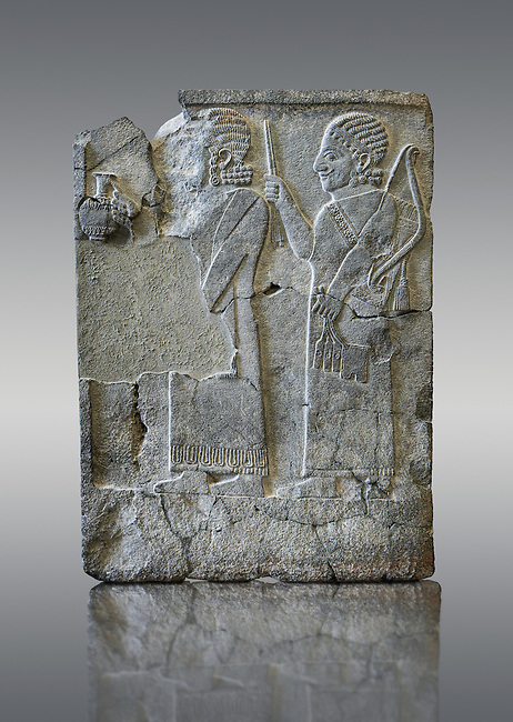 Relief panels Orthostats with representation from court officials de front a vessel, the second supporting arms. Found in North Hall of Sam'al - Zincirli. Basalt 8th Century BC. Vorderasiatisches Museum, Pergamon Museum, Berlin, inv no 3000
