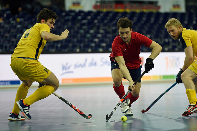 Leipzig, Germany, February 08: Alexander Zhirkov #7 of Russia controls the ball during the placement match (5th / 6th) between Sweden (yellow) and Russia (red) on February 8, 2015 at the FIH Indoor Hockey World Cup at Arena Leipzig in Leipzig, Germany. Final score 1-3 (1-0). (Photo by Dirk Markgraf / www.265-images.com) *** Local caption *** (L-R) Johan Bjoerkman #10 of Sweden, Alexander Zhirkov #7 of Russia