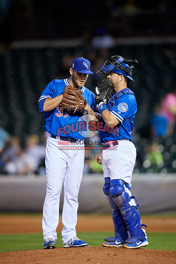 Oklahoma City Dodgers relief pitcher Madison Younginer (37) listens to catcher Kyle Farmer during a game against the Colorado Springs Sky Sox on June 2, 2017 at Chickasaw Bricktown Ballpark in Oklahoma City, Oklahoma.  Colorado Springs defeated Oklahoma City 1-0 in ten innings.  (Mike Janes/Four Seam Images)