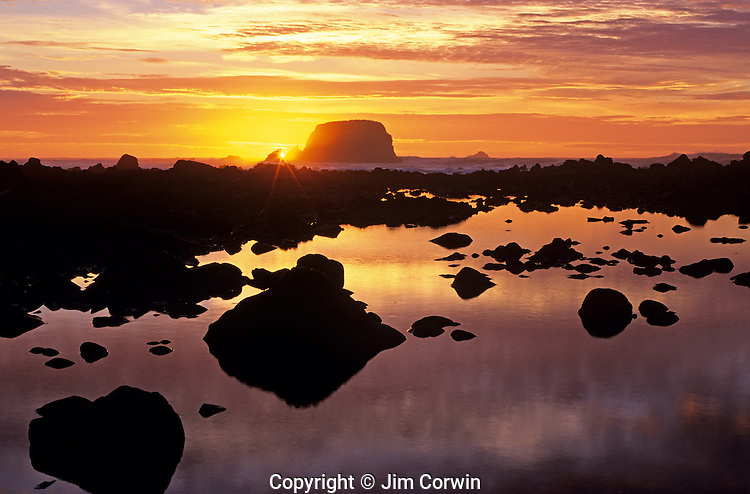 Sunset along California coastline at sunset with silhouetted rock formations Point Saint George California USA