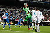 1st October 2017, Santiago Bernabeu, Madrid, Spain; La Liga football, Real Madrid versus Espanyol; Pau Lopez (1) Espanyol collects the ball safely under the watchful eye of Sergio Ramos Garcia (4) Real Madrid and Cristiano Ronaldo dos Santos (7) Real Madrid