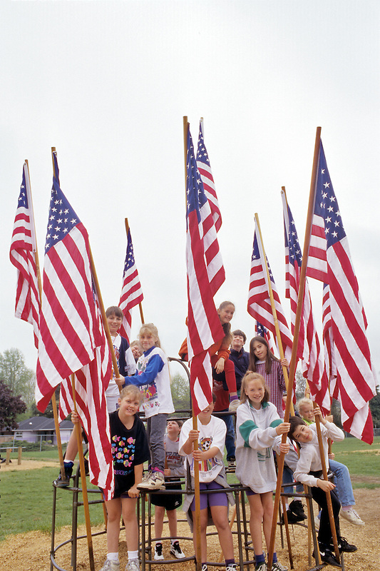 Fourth and fifth grade students with American flags. Corvalis, Oregon.