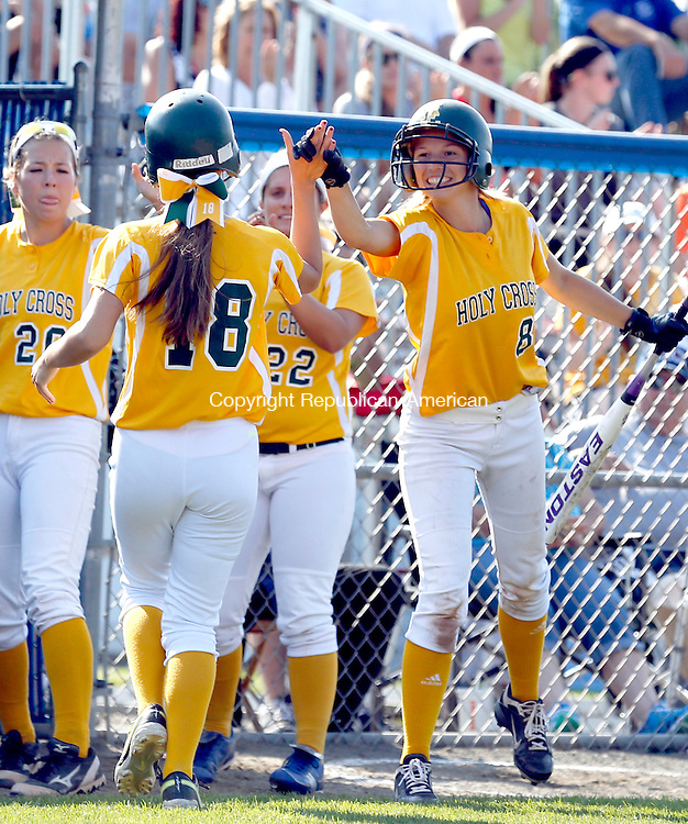 West Haven, CT- 10 June 2015-061015CM03- Holy Cross' players including Sydney McIldowie #8 congratulate Becca Anderson #18 after scoring a run against East Granby during their Class S semi-final matchup in West Haven on Wednesday.  Cross won, 2-0 advancing to Class S state finals.    Christopher Massa Republican-American
