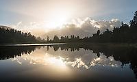 Southern Alps reflecting in Lake Matheson at sunrise, Westland Tai Poutini National Park, UNESCO World Heritage Area, West Coast, New Zealand, NZ