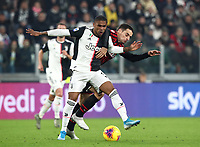 Calcio, Serie A: Juventus - Milan, Turin, Allianz Stadium, November 10, 2019.<br /> Juventus' Douglas Costa (l) in action with Milan's Giacomo Bonaventura (r) during the Italian Serie A football match between Juventus and Milan at the Allianz stadium in Turin, November 10, 2019.<br /> UPDATE IMAGES PRESS/Isabella Bonotto