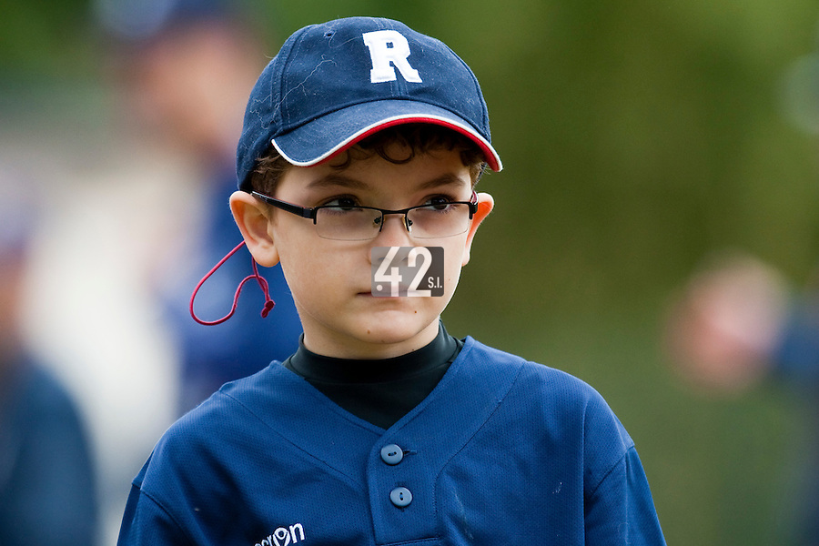 03 october 2009: Young fan and baseball player Victor Rolland is seen prior to game 1 of the 2009 French Elite Finals won 6-5 by Rouen over Savigny in the 11th inning, at Stade Pierre Rolland stadium in Rouen, France.