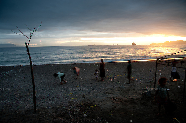 This family combs the beach every morning looking for recyclable rubbish that they can sell. They start work before dark because in Timor-Leste, even the rubbish is such a valuable commodity for the poorest people that they have to beat the competition to get to it.