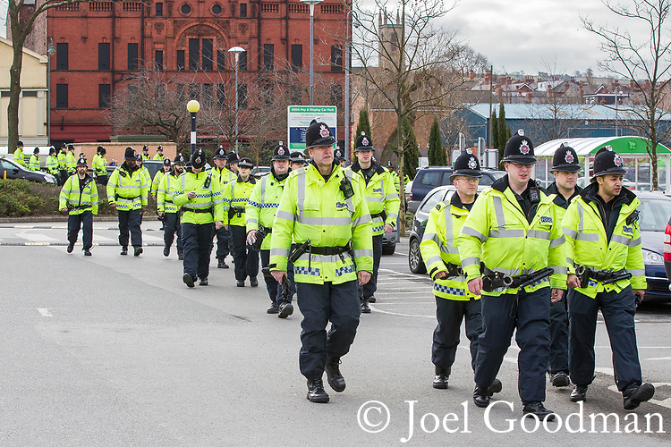 © Joel Goodman - 07973 332324 . 25/02/2012 . Hyde , UK . A large policing operation in the town . The EDL demonstrate following an assault on Daniel Stringer-Prince, whose family say they do not want the demonstration to take place in the town in their son's name. The EDL say Daniel was assaulted by a gang of Asian men . At the same time , the BNP hold a rally in the town . Photo credit : Joel Goodman