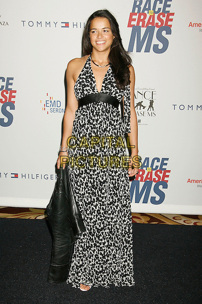 "MICHELLE RODRIGUEZ.14th Annual Race to Erase MS Themed ""Dance to Erase MS"" held at the Century Plaza Hotel, Century City, California, USA, 13 April 2007..full length black and white print halterneck dress.CAP/ADM/RE.©Russ Elliot/AdMedia/Capital Pictures."