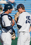 February 24, 2012:   Nevada Wolf Pack catcher Carlos Escobar talks with starting pitcher Bradey Shipley against the Utah Valley Wolverines during their NCAA baseball game played at Peccole Park on Friday afternoon in Reno, Nevada.
