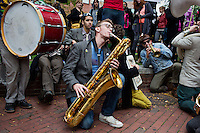 Members of Church Marching Band of  Santa Rosa, California, perform in Harvard Square in Cambridge, Massachusetts, USA, during the HONK! Festival.  The HONK! Festival is an annual gathering of activist street marching bands that involves performances, a parade between Davis Square in Somerville and Harvard Square in Cambridge, and an academic symposium about street music.