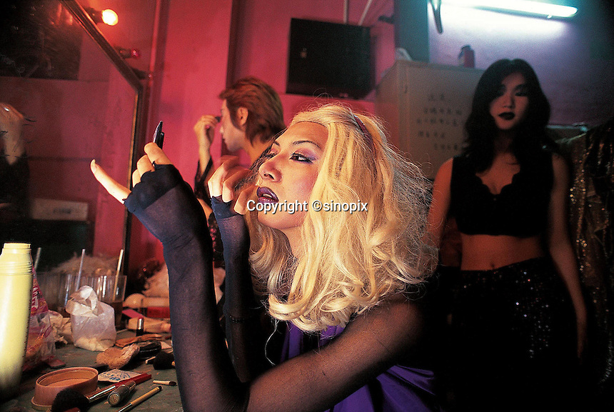 Tranverstites putting on make up in a night club in Guangzhou, China.