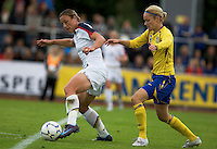 Abby Wambach (l) controls the ball in front of Sweden's Stina Segerström (r) during the match against Sweden, Landskamp, Sweden, July 5th, 2008.
