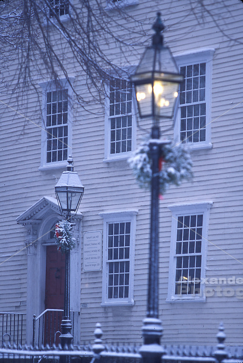 Usa, Newport, RI - A home on Washington Square park in winter with decorated gaslamps for the Christmas Holiday.