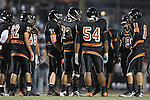 Beverly Hills, CA 09/23/11 - Brandon Adams (Beverly Hills #11), Eric Simsolo (Beverly Hills #62), Legend Waters (Beverly Hills #71), Jeraud Williams (Beverly Hills #73) and \b54\ in action during the Peninsula-Beverly Hills Varsity football game.